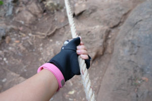woman's hand climbing mountain